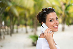 Woman calling on smartphone during caribbean travel vacation Stock Images
