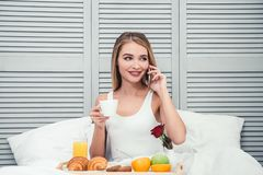 Woman calling on smartphone stock images