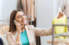 Woman calling on smartphone at clothing store Royalty Free Stock Image