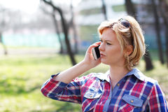 Woman calling by smartphone in part Royalty Free Stock Images