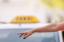 Woman calling taxi Stock Photo