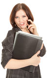 Woman calling to phone and holding a black folder Stock Image