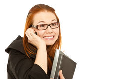 Woman calling to phone and holding a black folder Stock Images