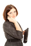 Woman calling to phone and looking to the camera Royalty Free Stock Images