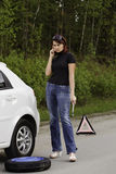 Woman calling to a service Stock Photos