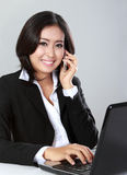 Woman calling using mobile phone Royalty Free Stock Photography