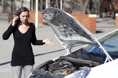 Woman calls after car is broken Stock Image