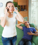 Woman calls to medicine for sick guy Royalty Free Stock Photography