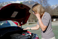 Woman calls the tow truck. Because the car will not start Stock Photos