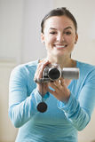 Woman with Camcorder Stock Images