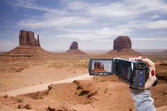 Woman with camcorder. In Monument Valley, Arizona Royalty Free Stock Images
