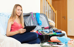 Woman came home from vacation and watching images Royalty Free Stock Photos