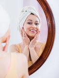 Woman came from the shower and standing next to the mirror Royalty Free Stock Photos