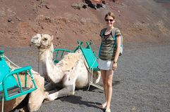 Woman and camel Royalty Free Stock Photography