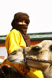 Woman and camel Stock Photo
