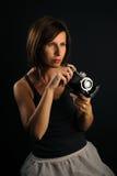 Woman with camera Stock Photos
