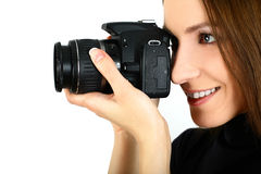 Woman with camera Stock Images