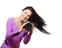 Woman with a camera Stock Images