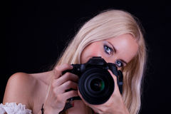 Woman and camera Stock Photos