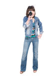 Woman with camera. Young adult brunette woman with old camera Stock Photo