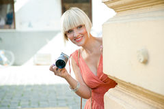 Woman with camera Stock Photos