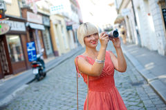 Woman with camera Royalty Free Stock Photography