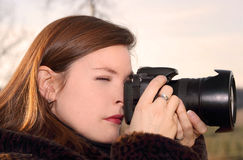 Woman and camera Royalty Free Stock Images