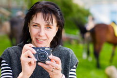 Woman and camera. Female photograph with camera outdoor Stock Image