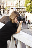 Woman with the camera Stock Image