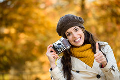 Woman with camera in autumn taking photo Royalty Free Stock Photo