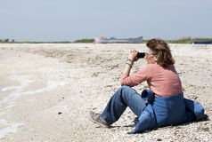 Woman with camera Stock Photography