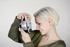 Woman with camera. Beautiful young woman with old camera Stock Photography