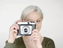 Woman with camera. Beautiful young woman with old camera Stock Images