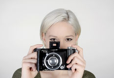Woman with camera. Beautiful young woman with old camera Royalty Free Stock Image