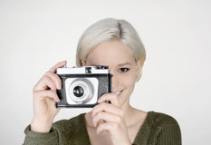 Woman with camera. Beautiful young woman with old camera Stock Image