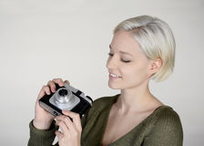 Woman with camera. Beautiful young woman with old camera Royalty Free Stock Photos
