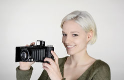 Woman with camera. Beautiful young woman with old camera Stock Photos
