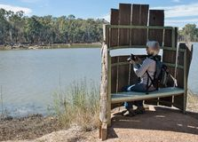 Woman With Camera in Bird Hide. Royalty Free Stock Photo