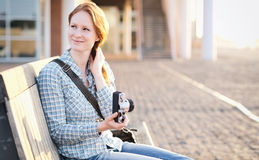 Woman with a Camera in a City at Sunset Royalty Free Stock Photos