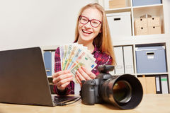 Woman with camera earning money Royalty Free Stock Photo