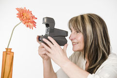 Woman with camera and flower Royalty Free Stock Image