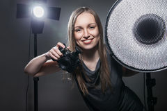 Woman with the camera. Girl photographer Stock Photo