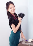 Woman and camera in hand Royalty Free Stock Image