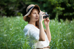 Woman with a camera in hand Royalty Free Stock Images