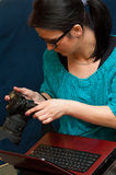 Woman with camera and laptop stock photos