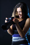 Woman with camera looking at great shot Stock Photo
