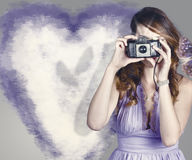 Woman with camera. Love in a still frame capture Royalty Free Stock Photography