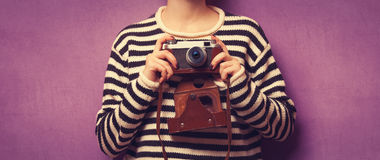 Woman with camera o Royalty Free Stock Image