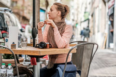 Woman with camera in outdoor cafe. Barcelona, Catalonia. Royalty Free Stock Image