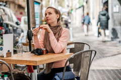 Woman with camera in outdoor cafe. Barcelona, Catalonia. Stock Images